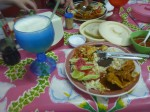 Got this in Tulum for 60 pesos ($4.80) awesome home made pineapple juice with chicken, pork,rice,beans, salad and taco's