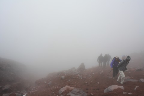 Us climbing up through the mist to the glaciers of Cotopaxi